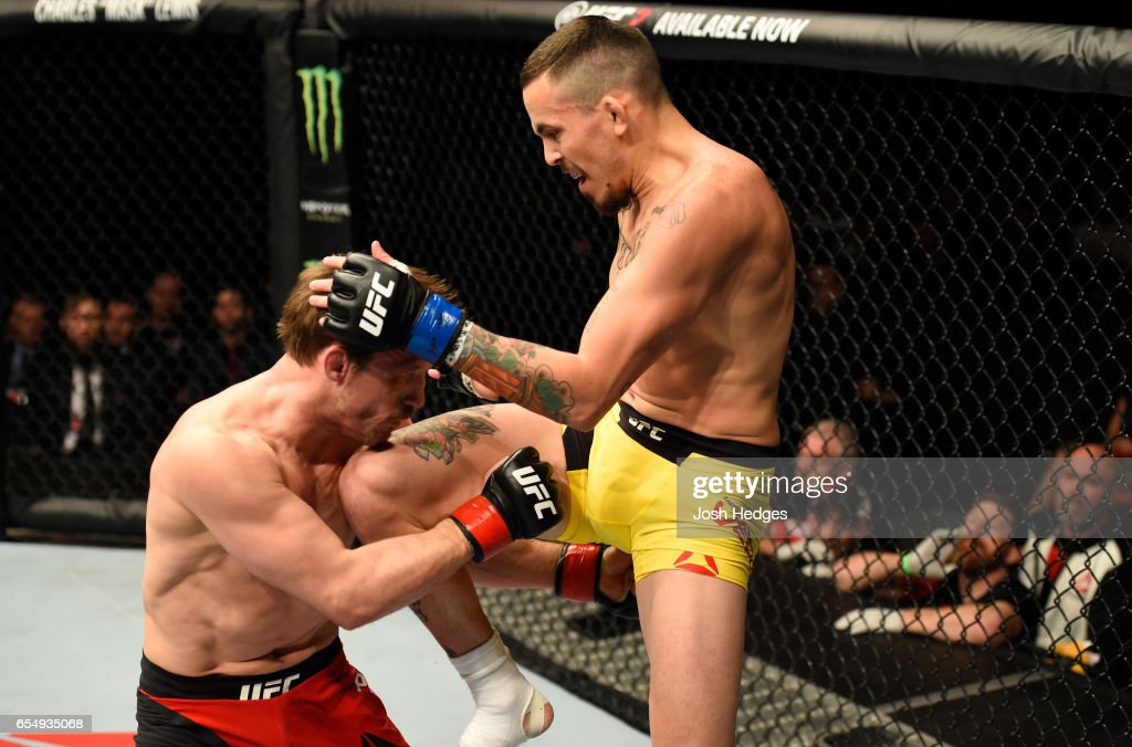 Marlon Vera of Ecuador kneees Brad Pickett of England in their bantamweight fight during the UFC Fight Night event at The O2 arena on March 18, 2017 in London, England.