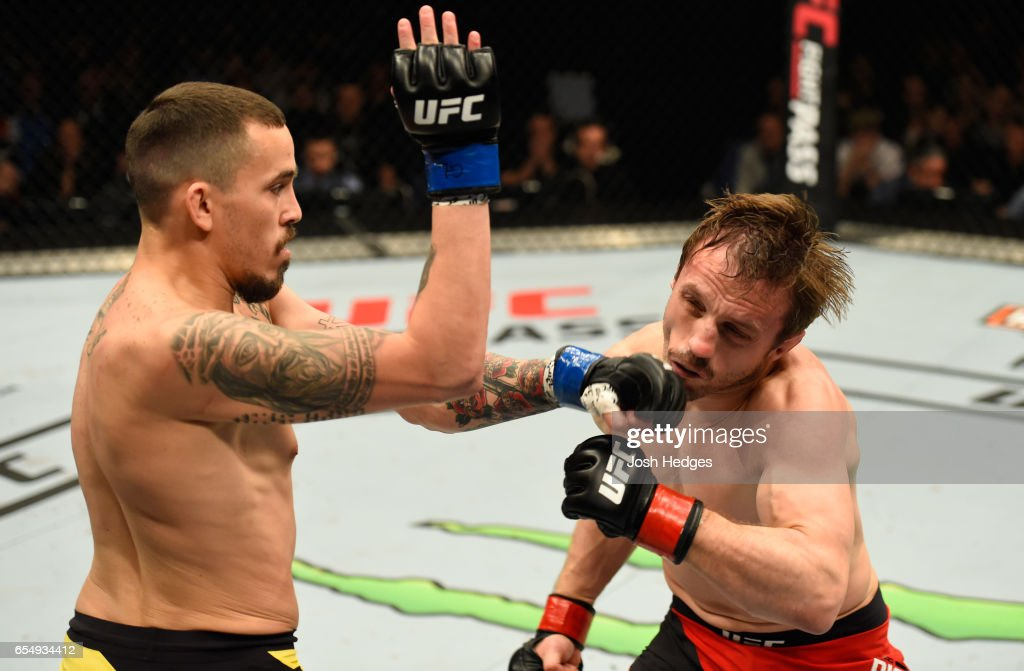 Marlon Vera of Ecuador punches Brad Pickett of England in their bantamweight fight during the UFC Fight Night event at The O2 arena on March 18, 2017 in London, England.