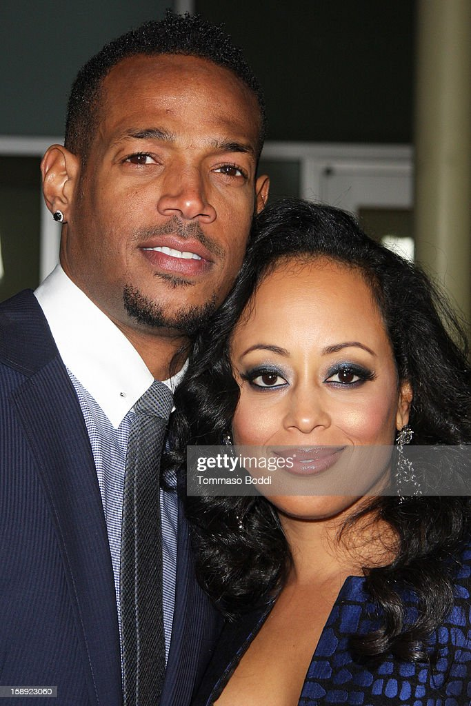 <a gi-track='captionPersonalityLinkClicked' href=/galleries/search?phrase=Marlon+Wayans&family=editorial&specificpeople=203226 ng-click='$event.stopPropagation()'>Marlon Wayans</a> (L) and <a gi-track='captionPersonalityLinkClicked' href=/galleries/search?phrase=Essence+Atkins&family=editorial&specificpeople=225171 ng-click='$event.stopPropagation()'>Essence Atkins</a> attend the 'A Haunted House' Los Angeles premiere held at the ArcLight Hollywood on January 3, 2013 in Hollywood, California.