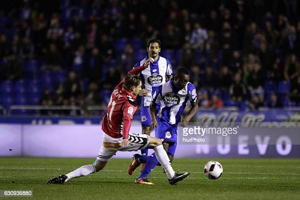 Marlos Moreno of Deportivo de La Coruna compete for the ball against Kiko Femenia of Deportivo Alaves SAD during the spanish 1/8 Copa del Rey match...