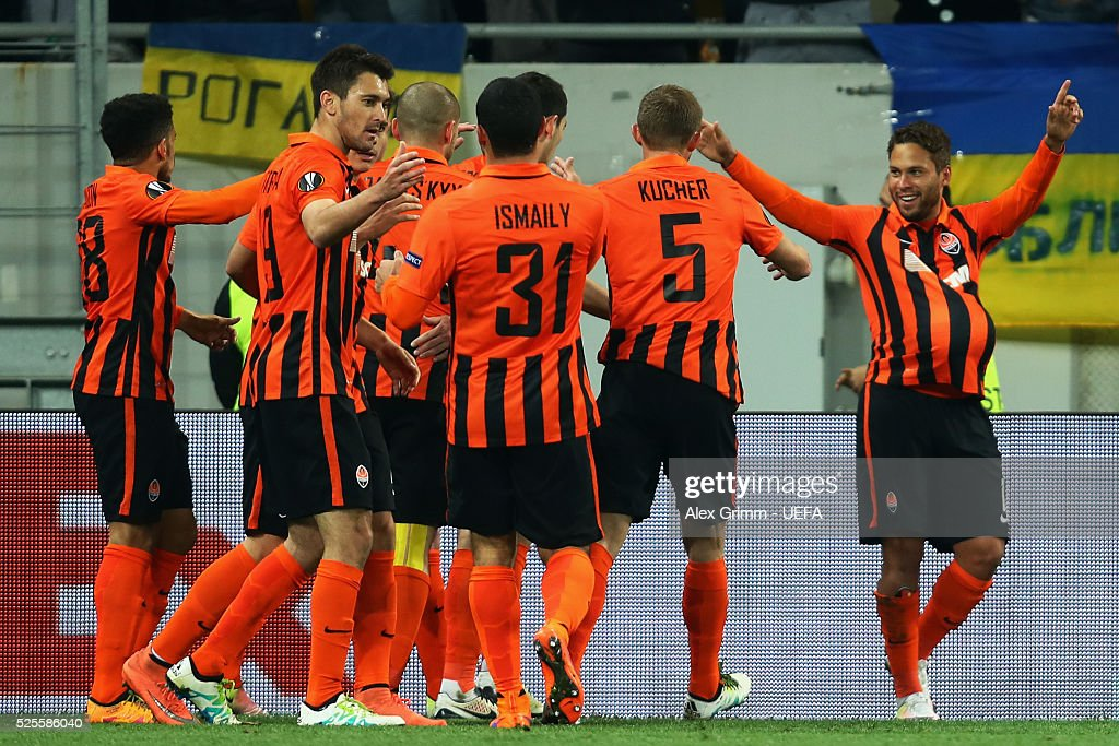 Marlos (R) of Shakhtar celebrates his team's first goal with team mates during the UEFA Europa League Semi Final first leg match between Shakhtar Donetsk and Sevilla at Arena Lviv on April 28, 2016 in Lviv, Ukraine.