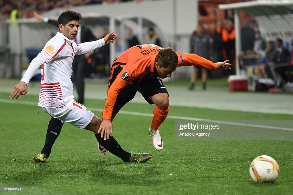 Marlos of Shakhtar Donetsk (R) competes for the ball with Ever Banega (L) of Sevilla FC during the UEFA Europa League Semi-finals soccer match between Shakhtar Donetsk and Sevilla FC at Lviv Arena stadium on April 28, 2016, in Lviv, Ukraine.