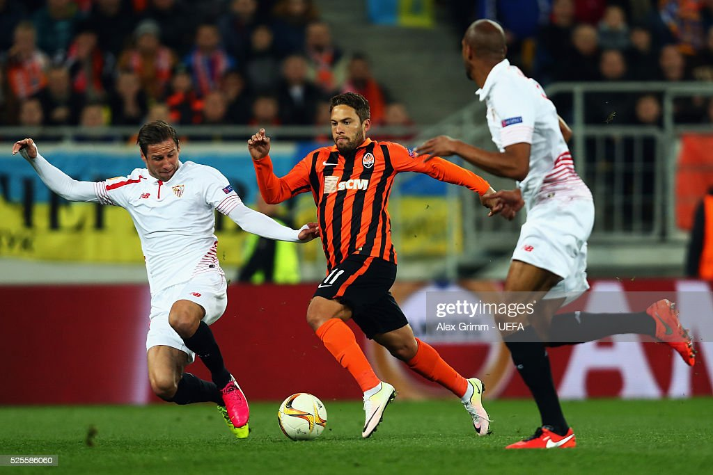 Marlos (C) of Shakhtar is challenged by Grzegorz Krychowiak (L) and Steven N'Zonzi (R) of Sevilla during the UEFA Europa League Semi Final first leg match between Shakhtar Donetsk and Sevilla at Arena Lviv on April 28, 2016 in Lviv, Ukraine.