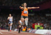 Marlou Van Rhijn of Netherlands crosses the line to win gold in the Women's 200m T44 Final on day 8 of the London 2012 Paralympic Games at Olympic...