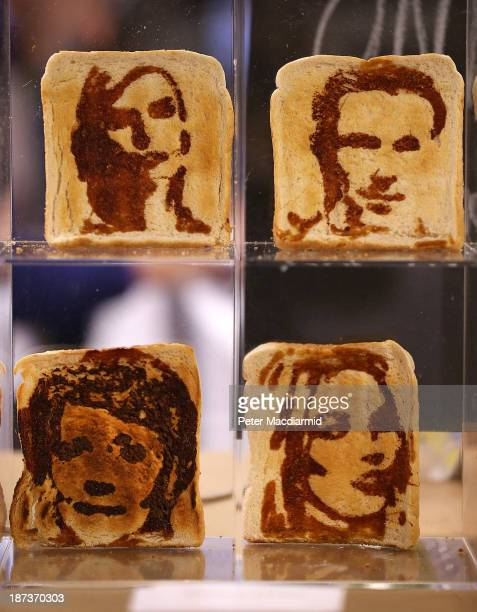 Marmite spread painted toast portraits are displayed at the Experimental Food Society Exhibition on November 8 2013 in London England A collective of...