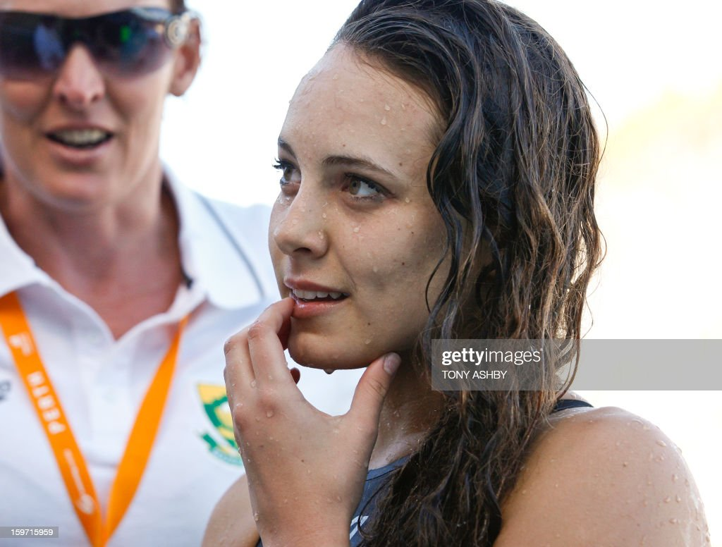 Marne Erasmus of South Africa reacts after finishing third in the women's 100 metres butterfly race on day two at the Aquatic Super Series swimming competition in Perth on January 19, 2013. AFP PHOTO/Tony ASHBY IMAGE