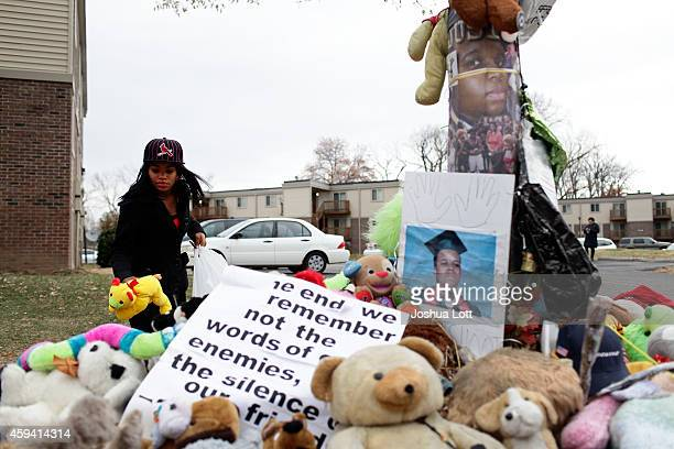 Marneisha Jones places a stuff animal at a makeshift memorial for Michael Brown November 22 2014 in Ferguson Missouri Brown a 18yearold black male...