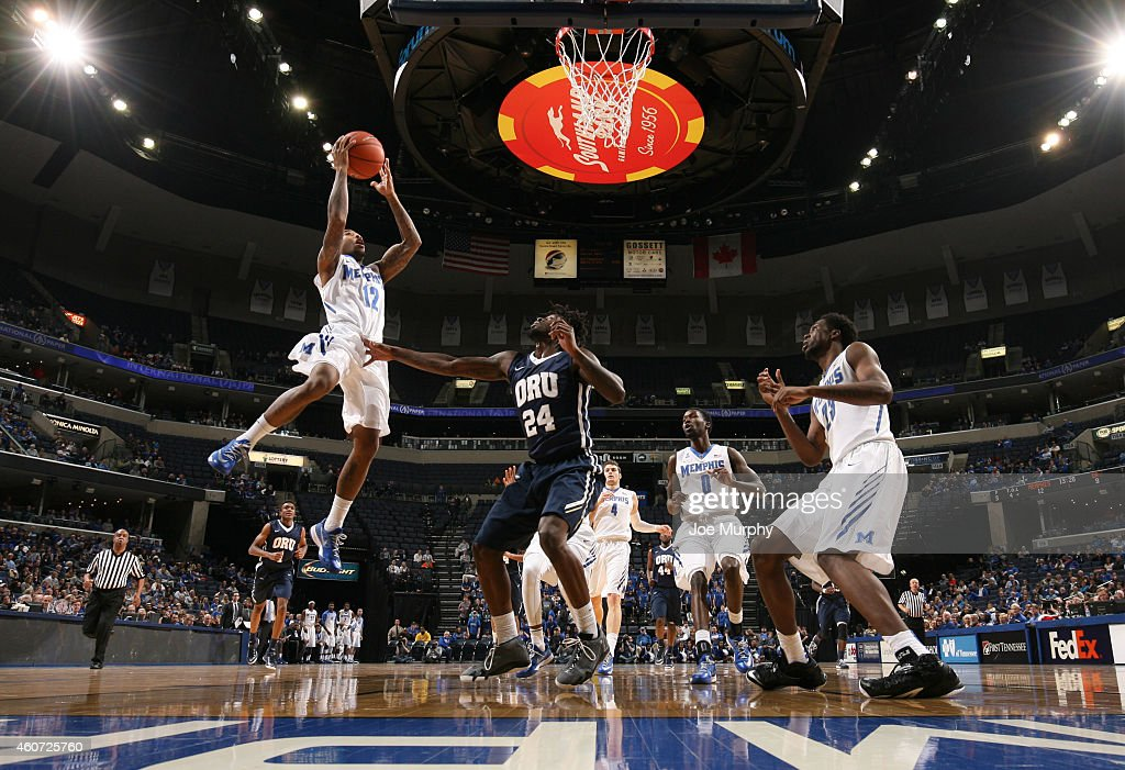 Marnier Cunningham of the Memphis Tigers drives to the basket for a layup against the Oral Roberts Golden Eagles on December 20 2014 at FedExForum in...