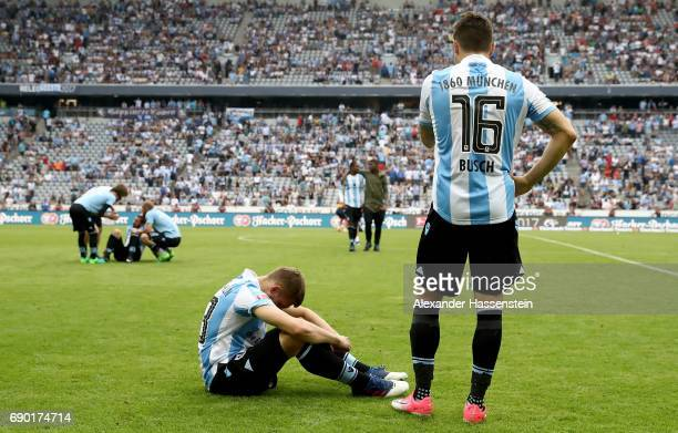 Marnon Busch of 1860 Muenchen and team mate Levent Aycicek look dejected after the Second Bundesliga Playoff second leg match betweenTSV 1860...