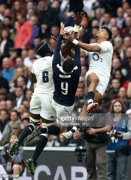 Maro Itoje and Anthony Watson of England compete for a high ball with Ali Price of Scotland during the RBS Six Nations match between England and...