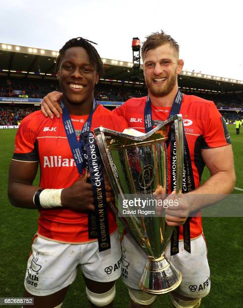 Maro Itoje and George Kruis of Saracens celebrate with the trophy following his team's 2817 victory during the European Rugby Champions Cup Final...