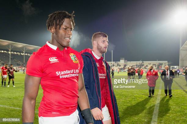 Maro Itoje and George Kruis of the Lions leave the field after their win in the match between the Crusaders and the British Irish Lions at AMI...