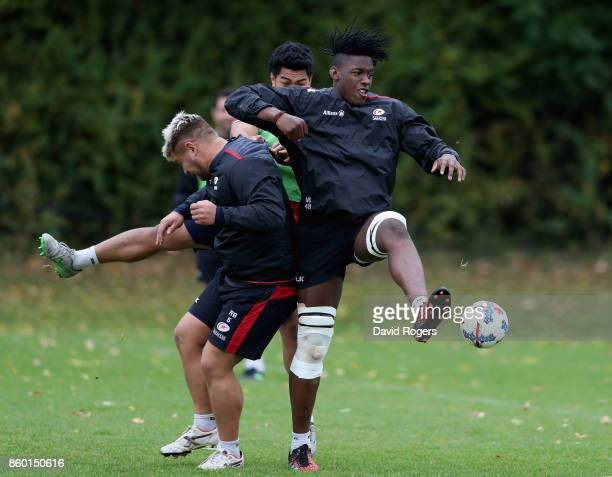 Maro Itoje beats Richard Barrington to the ball in a warm up game of football during the Saracens training session held at Old Albanians on October...