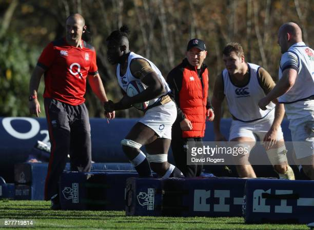Maro Itoje breaks with the ball during the England training session held at Pennyhill Park on November 23 2017 in Bagshot England