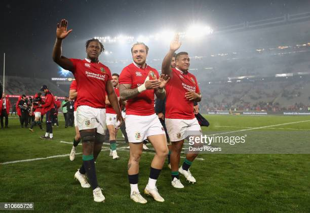 Maro Itoje Jack Nowell and Mako Vunipola of the Lions acknowedge the support of the Lions supporters after they draw the final test 1515 and tie the...