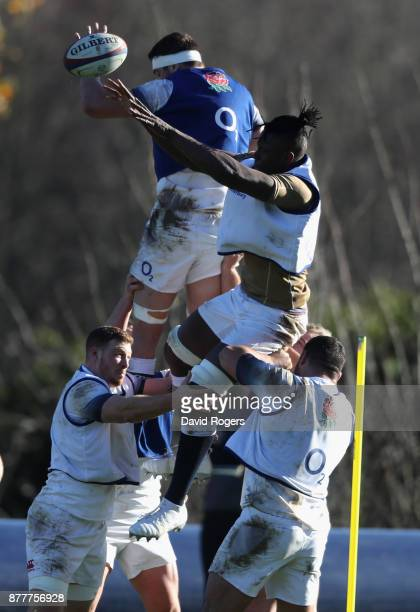 Maro Itoje jumps for the ball against Charlie Ewels during the England training session held at Pennyhill Park on November 23 2017 in Bagshot England