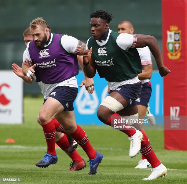 Maro Itoje leads Joe Marler as they sprint during the British and Irish Lions training session held at Carton House Golf Club on May 22 2017 in...