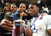 Maro Itoje of England celebrates with the trophy following his team's 3121 victory during the RBS Six Nations match between France and England at the...