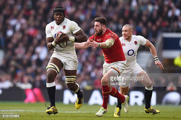 Maro Itoje of England goes past Alex Cuthbert of Wales during the RBS Six Nations match between England and Wales at Twickenham Stadium on March 12...