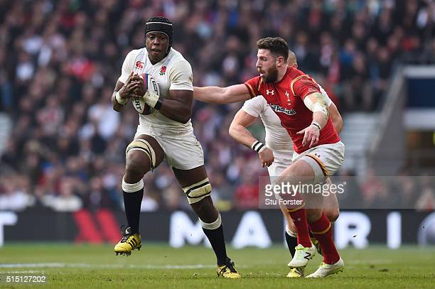 Maro Itoje of England is pursued by Alex Cuthbert of Wales during the RBS Six Nations match between England and Wales at Twickenham Stadium on March...