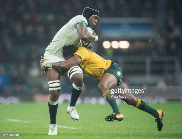 Maro Itoje of England is tackled by Marika Koroibete of Australia during the Old Mutual Wealth Series autumn international match between England and...