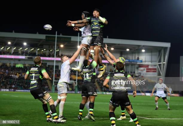 Maro Itoje of Saracens is challenged by Courtney Lawes during the European Rugby Champions Cup match between Northampton Saints and Saracens at...