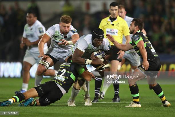 Maro Itoje of Saracens is tackled b Dylan Hartley during the European Rugby Champions Cup match between Northampton Saints and Saracens at Franklin's...