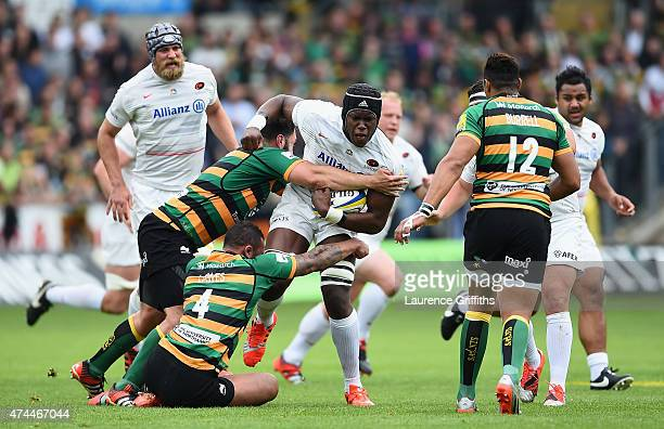 Maro Itoje of Saracens is tackled by Courtney Laws of Northampton Saints during the Aviva Premiership Play Off Semi Final between Northampton Saints...