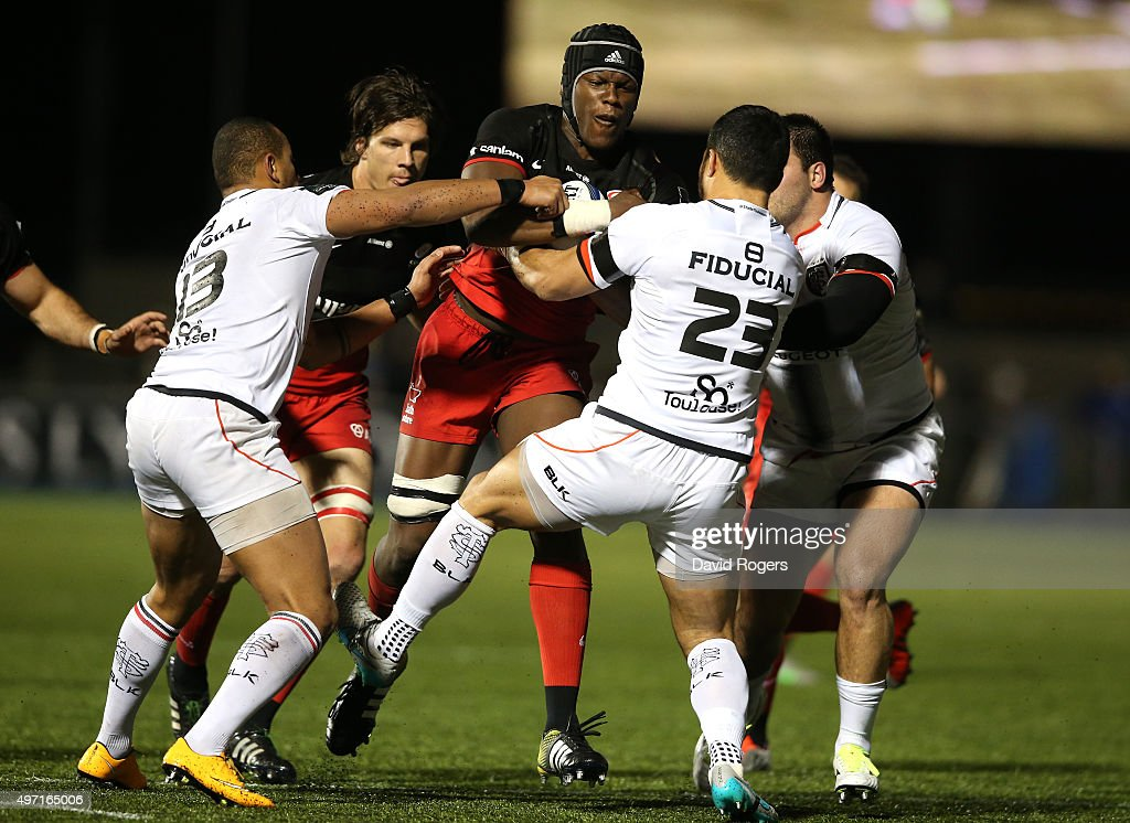 <a gi-track='captionPersonalityLinkClicked' href=/galleries/search?phrase=Maro+Itoje&family=editorial&specificpeople=5967858 ng-click='$event.stopPropagation()'>Maro Itoje</a> of Saracens is tackled by Yann David (R) and Gael Fickou during the European Rugby Champions Cup match between Saracens and Toulouse at Allianz Park on November 14, 2015 in Barnet, England.