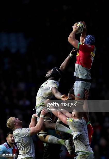 Maro Itoje of Saracens jumps against James Horwill Captain of Harlequins during the Aviva Premiership match between Harlequins and Saracens at...