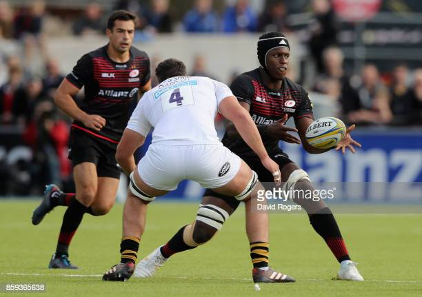 Maro Itoje of Saracens passes the ball during the Aviva Premiership match between Saracens and Wasps at Allianz Park on October 8 2017 in Barnet...
