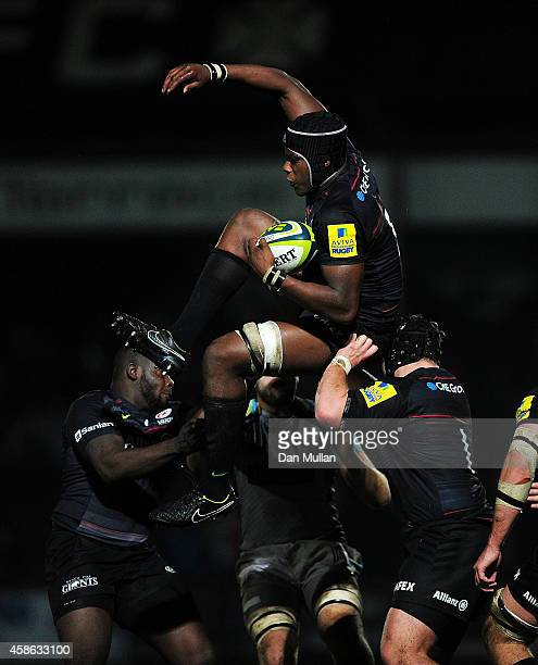 Maro Itoje of Saracens rises to claim the restart during the LV= Cup match between Ospreys and Saracens at The Gnoll on November 7 2014 in Neath Wales