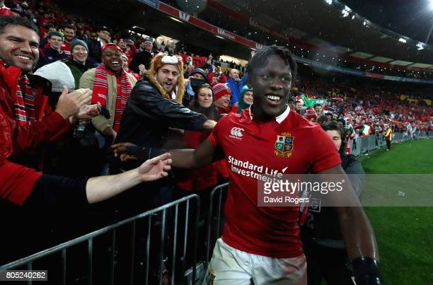 Maro Itoje of the Lions celebrates with friends and family after their victory during the match between the New Zealand All Blacks and the British...