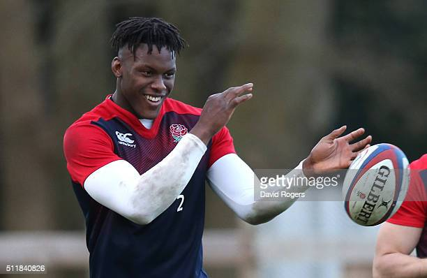 Maro Itoje passes the ball during the England training session held at Pennyhill Park on February 23 2016 in Bagshot England