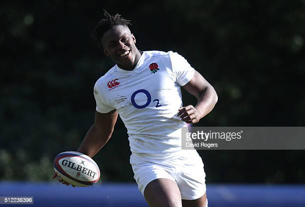 Maro Itoje runs with the ball during the England training session held at Pennyhill Park on February 25 2016 in Bagshot England