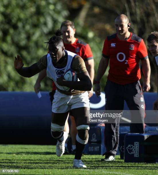 Maro Itoje runs with the ball during the England training session held at Pennyhill Park on November 23 2017 in Bagshot England