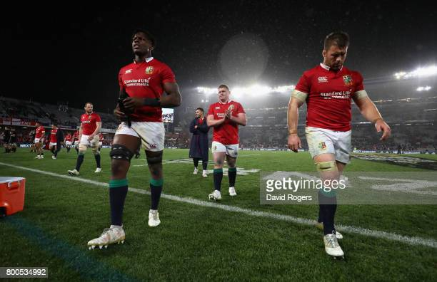 Maro Itoje Tadhg Furlong and Sean O'Brien of the Lions walks off the pitch after their defeat during the Test match between the New Zealand All...