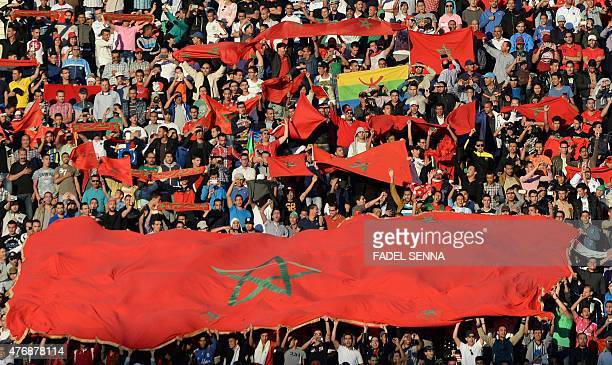 Maroccan supporters hold flags during the 2017 Africa Cup of Nations qualifying football match against Libya in Agadir on June 12 2015 AFP PHOTO /...