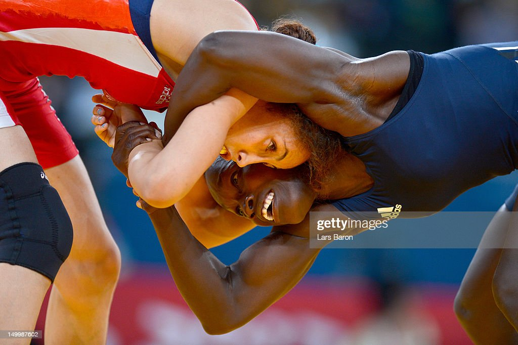 Maroi Mezien of Tunisia competes against Isabelle Sambou of Senegal during their Women's Freestyle 48 kg Wrestling match on Day 12 of the London 2012 Olympic Games at ExCeL on August 8, 2012 in London, England.