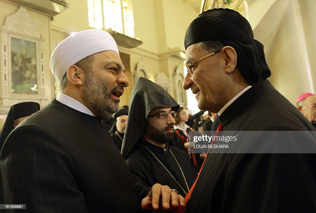 Maronite Patriarch Beshara Rai (R) is greeted by a Sunni Muslim Sheikh from Syria's Gand Mufti Ahmed Hassun's offices as they arrive to attend the enthronement of Syria's Greek Orthodox leader Yuhanna X Yazigi at the Holy Cross church in Damascus, during the first visit by a Maronite patriarch since Syrian independence in 1943, on February 10, 2013. Snipers were deployed on the rooftops around the church as dignitaries from Middle East churches arrived for the enthronement.
