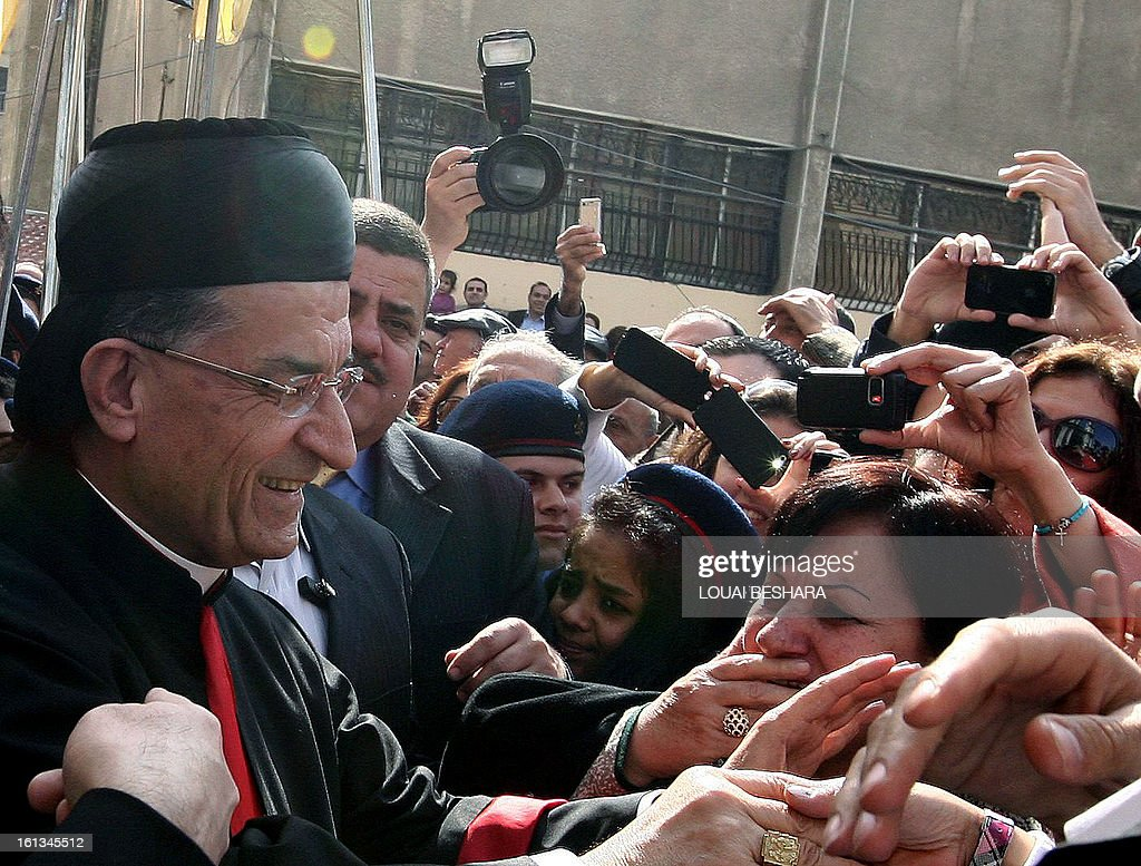 Maronite Patriarch Beshara Rai is greeted by supporters as he arrives to attend the enthronement of Syria's Greek Orthodox leader Yuhanna X Yazigi at the Holy Cross church in Damascus, during the first visit by a Maronite patriarch since Syrian independence in 1943, on February 10, 2013. Snipers were deployed on the rooftops around the church as dignitaries from Middle East churches arrived for the enthronement.