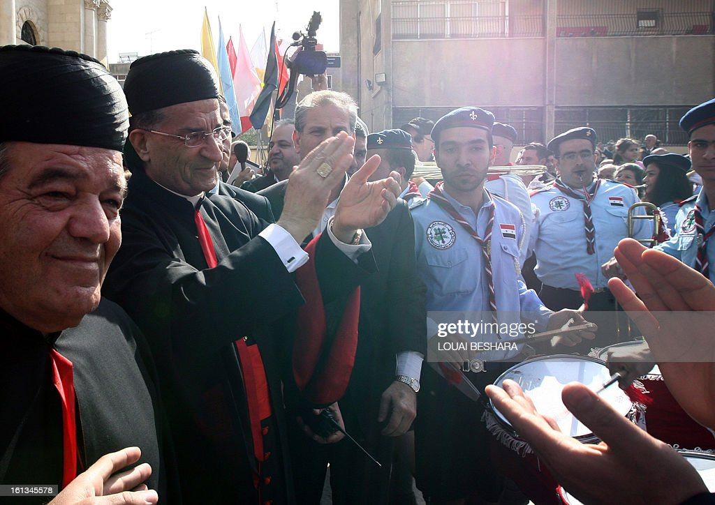 Maronite Patriarch Beshara Rai is greeted by supporters as he arrives to attend the enthronement of Syria's Greek Orthodox leader Yuhanna X Yazigi at the Holy Cross church in Damascus, during the first visit by a Maronite patriarch since Syrian independence in 1943, on February 10, 2013. Snipers were deployed on the rooftops around the church as dignitaries from Middle East churches arrived for the enthronement. AFP PHOTO / LOUAI BESHARA