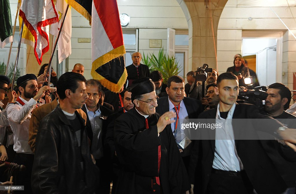 Maronite Patriarch Beshara Rai (C) waves to worshipers as he arrives to give a service at the Maronite Cathedral of Saint Anthony (Mar Antonios) in Bab Tuma, a predominantly Christian quarter of Damascus, on February 9, 2013. Rai's visit -- the first by a Maronite patriarch since Syrian and Lebanese independence in 1943 -- comes as the revolt against Syrian President Bashar al-Assad's regime nears the two-year mark.