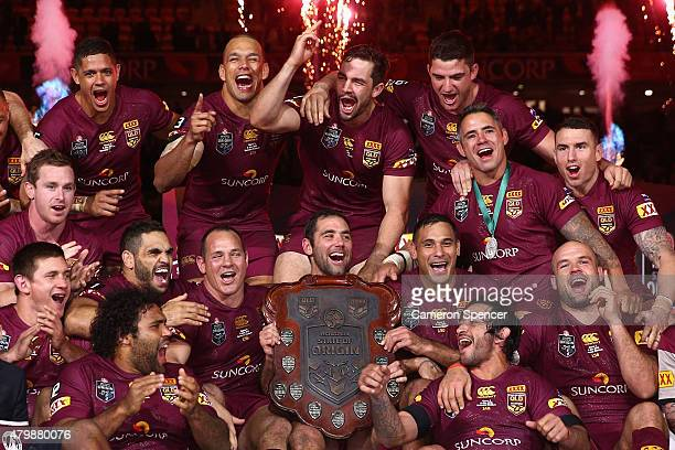 Maroons captain Cameron Smith and his team celebrate winning game three of the State of Origin series between the Queensland Maroons and the New...