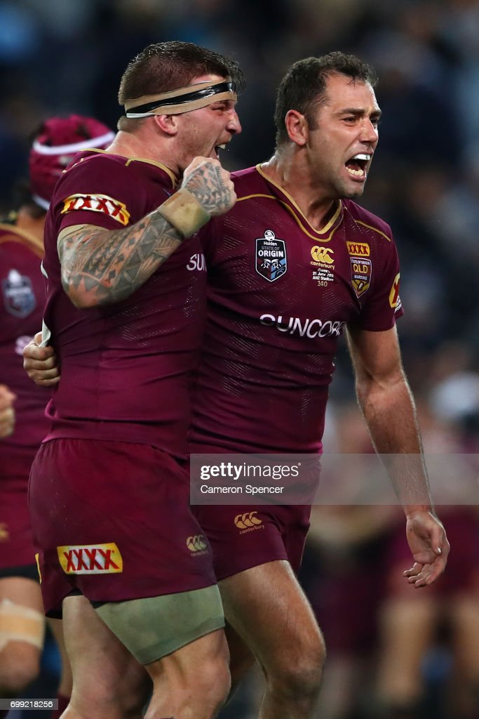 Maroons captain Cameron Smith and team mate Josh McGuire celebrate winning game two of the State Of Origin series between the New South Wales Blues and the Queensland Maroons at ANZ Stadium on June 21, 2017 in Sydney, Australia.