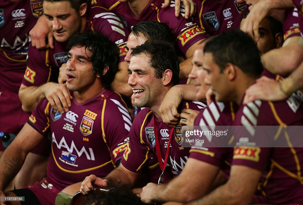 Maroons captain <a gi-track='captionPersonalityLinkClicked' href=/galleries/search?phrase=Cameron+Smith+-+Rugbyer&family=editorial&specificpeople=453295 ng-click='$event.stopPropagation()'>Cameron Smith</a> (C) celebrates with team mates after victory during game three of the ARL State of Origin series between the New South Wales Blues and the Queensland Maroons at ANZ Stadium on July 17, 2013 in Sydney, Australia.