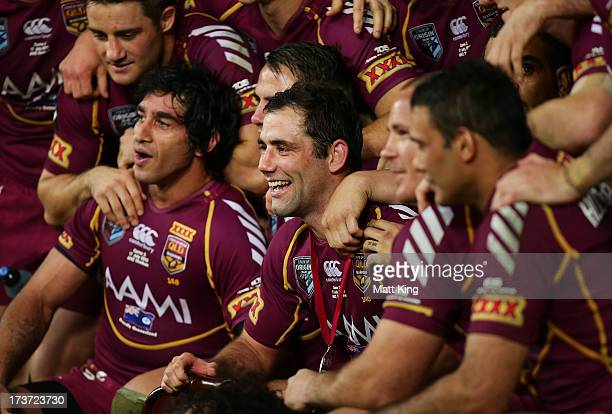Maroons captain Cameron Smith celebrates with team mates after victory during game three of the ARL State of Origin series between the New South...