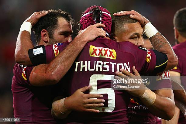 Maroons captain Cameron Smith congratulates Josh Papalii of the Maroons after scoring a try with team mate Johnathan Thurston during game three of...