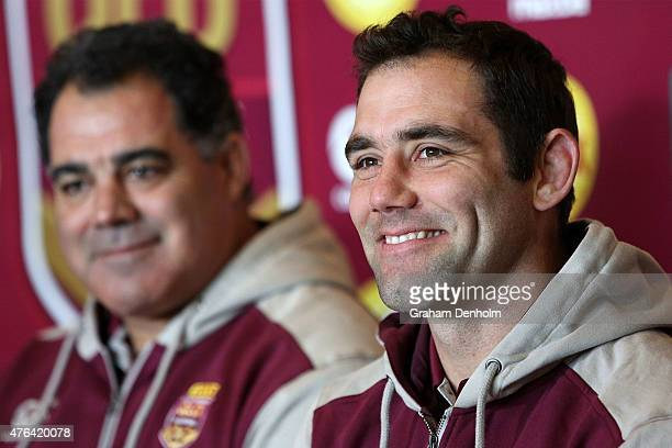 Maroons Coach Mal Meninga looks on as Cameron Smith talks to the media during the Queensland Maroons State of Origin team announcement at Melbourne...