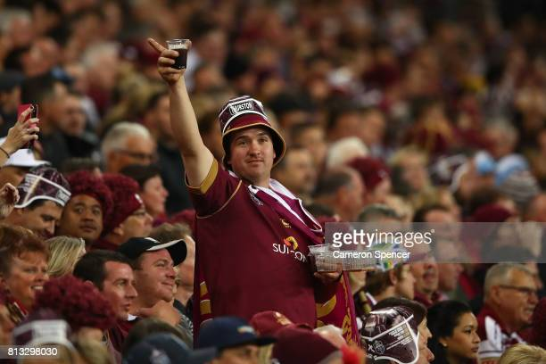 Maroons fan shows his support during game three of the State Of Origin series between the Queensland Maroons and the New South Wales Blues at Suncorp...